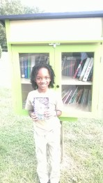 Caelan at the Little Library